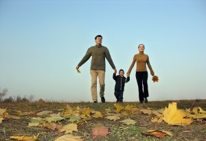 bigstockphoto_Walking_Family_Sundown_Autumn__238052.jpg